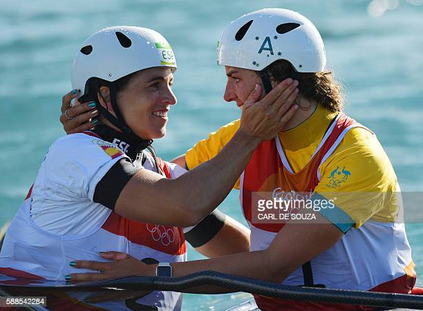 Spain's Maialen Chourraut celebrates with Australia's Jessica Fox after winning the Women's K1 final kayak slalom competition at the Whitewater...