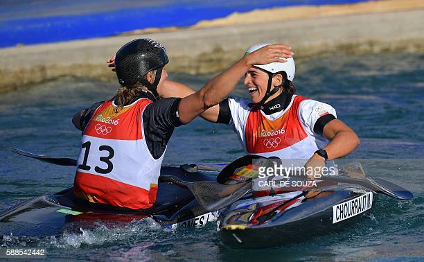 Spain's Maialen Chourraut celebrates with New Zealand's Luuka Jones after winning the Women's K1 final kayak slalom competition at the Whitewater...