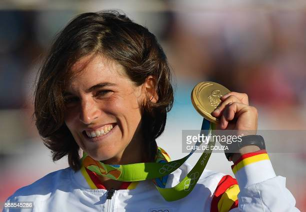 Spain's Maialen Chourraut holds her gold medal on the podium of the Women's K1 final kayak slalom competition at the Whitewater stadium during the...