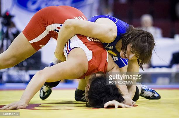 Spain's Maider Unda Gonzalez de Audicana and France's Cynthia Vescan compete in the women's Freestyle wrestling 72 kg category final during the...