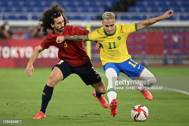 Spain's Marc Cucurella and Brazil's Antony vie for the ball during the Tokyo 2020 Olympic Games football competition men's gold medal match at...