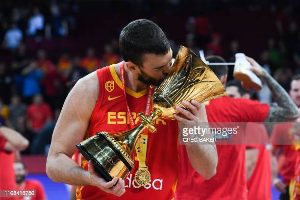 TOPSHOT Spain's Marc Gasol celebrates with their winning trophy at the end of the Basketball World Cup final game between Argentina and Spain in...