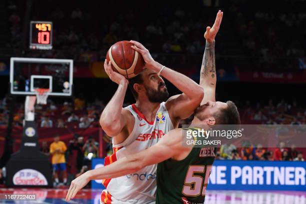 TOPSHOT Spain's Marc Gasol fights for the ball with Australia's Patty Mills during the Basketball World Cup semifinal game between Australia and...