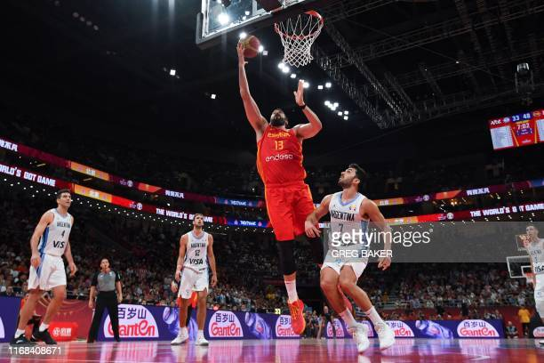 Spain's Marc Gasol goes to the basket next to Argentina's Facundo Campazzo during the Basketball World Cup final game between Argentina and Spain in...