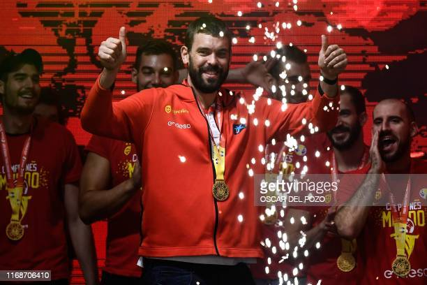 Spain's Marc Gasol waves to supporters from the stage upon the arrival of the Spain's national team on Colon Square in Madrid on September 16 to...