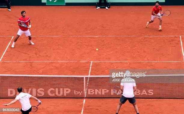 Spain's Marc Lopez and Spain's Feliciano Lopez return the ball during the Davis Cup quarterfinal doubles tennis match against Germany's Tim Puetz and...