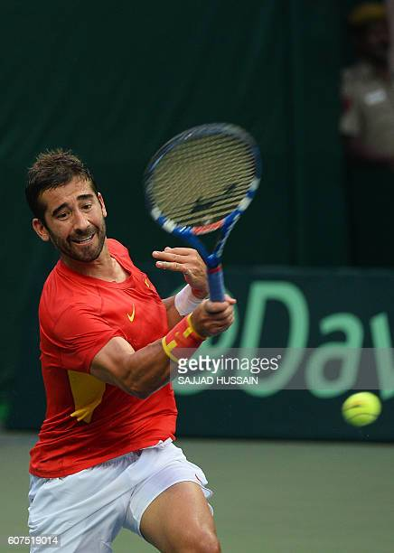 Spain's Marc Lopez returns a shot against India's player Sumit Nagal during their Davis Cup singles tennis match in New Delhi on September 18 2016 /...