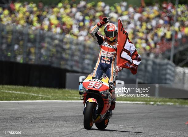 TOPSHOT Spain's Marc Marquez celebrates after placing second of the Italian Moto GP Grand Prix at the Mugello race track on June 2 2019 in Scarperia...