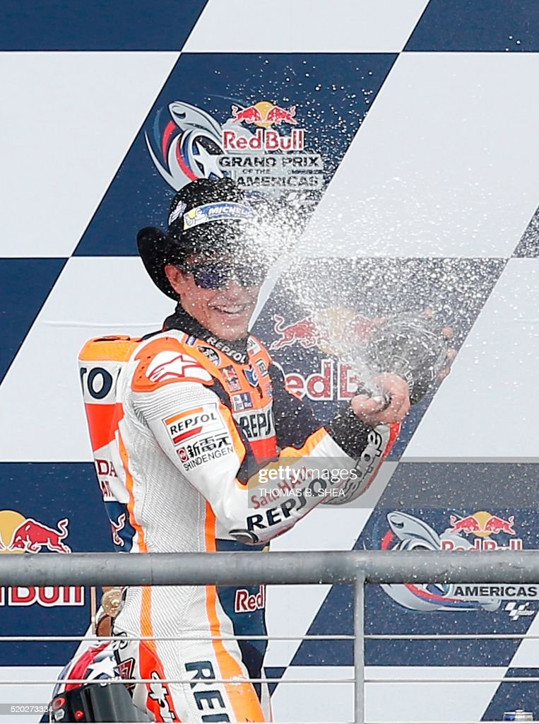 Spain's Marc Marquez (93) celebrates his victory in the 2016 Grand Prix of the Americas MotoGP race at Circuit of the Americas, in Austin, Texas on April 10, 2016. / AFP / Thomas B. Shea