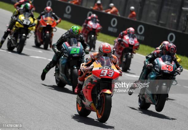 Spain's Marc Marquez Italy's Franco Morbidelli France's Fabio Quartararo and riders take the start of the Italian Moto GP Grand Prix at the Mugello...
