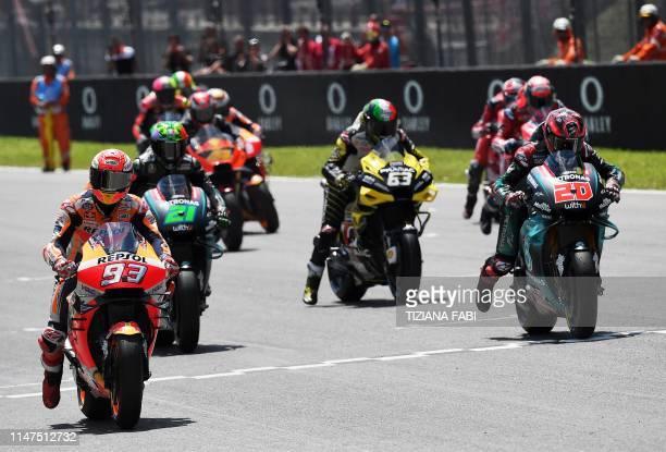 Spain's Marc Marquez Italy's Franco Morbidelli Italy's Francesco Bagnaia and France's Fabio Quartararo wait at the start line prior to the Italian...