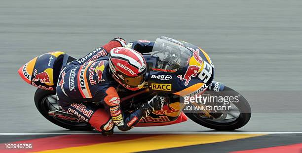 Spain's Marc Marquez of the Red Bull Ajo Motorsport team steers his bike during the qualifying practice of the 125cc race at the Sachsenring Circuit...
