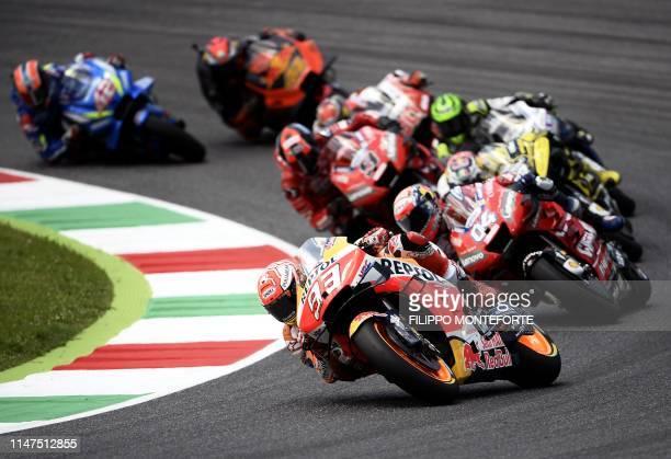 Spain's Marc Marquez rides his Honda ahead of Italy's Andrea Dovizioso riding his Ducati during the Italian Moto GP Grand Prix at the Mugello race...