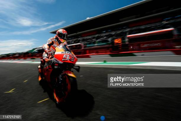 TOPSHOT Spain's Marc Marquez rides his Honda back in the pits during free practice 4 ahead the Italian Moto GP Grand Prix at the Mugello race track...