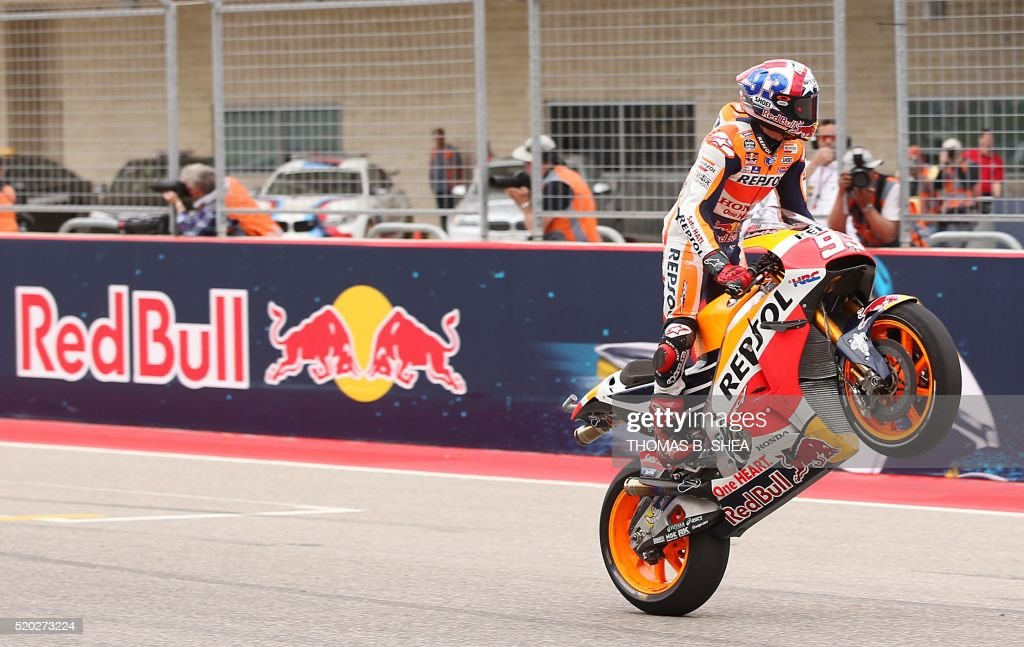 Spain's Marc Marquez (93) who finished first celebrates his win by crossing the finish line with a stand up wheelie in the 2016 Grand Prix of the Americas MotoGP race at Circuit of the Americas, in Austin, Texas on April 10, 2016. / AFP / Thomas B. Shea