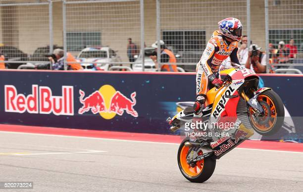 Spain's Marc Marquez who finished first celebrates his win by crossing the finish line with a stand up wheelie in the 2016 Grand Prix of the Americas...