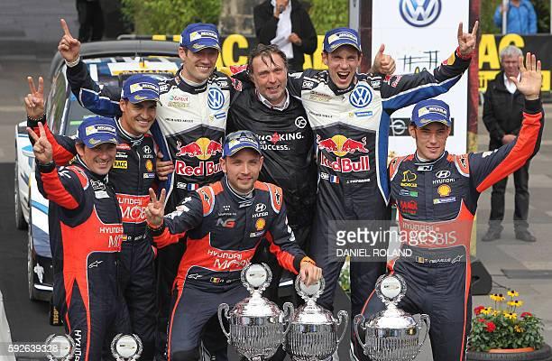 Spain's Marc Marti and Dani Sordo, France's Sebastien Ogier, Belgium's Nicolas Gilsoul, Volkswagen motorsport manager Jost Capito, France's Julien...