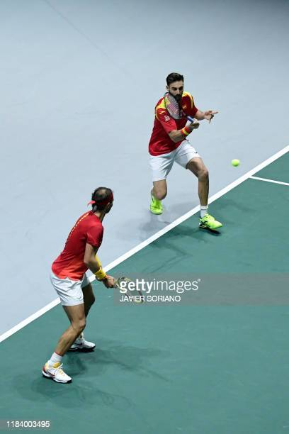 Spain's Marcel Granollers and Spain's Rafael Nadal return the ball to Argentina's Leonardo Mayer and Argentina's Maximo Gonzalez during the doubles...
