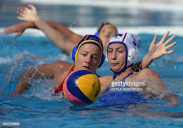 Spain's Maria Garcia fights for the ball with Russia's Ekaterina Prokofyeva during the Water Polo European Championships match for women between...