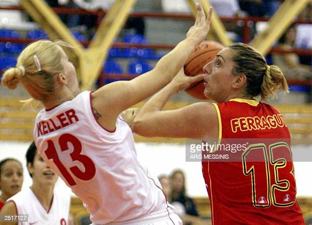 Spain's Marina Ferragut tries to face the basket as Hungary's Annamaria Keller tries to stop her during a group B preliminary game for the Women...