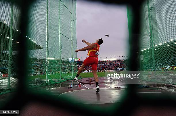 Spain's Mario Pestano competes in the men's discus throw final at the 2012 European Athletics Championships at the Olympic Stadium in Helsinki on...