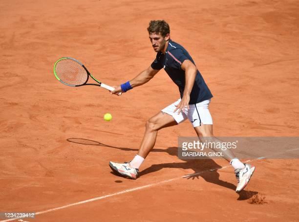 Spain's Mario Vilella Martinez returns the ball to Austria's Lukas Neumayer during their men's singles match at the Generali Open Tennis Tournament...