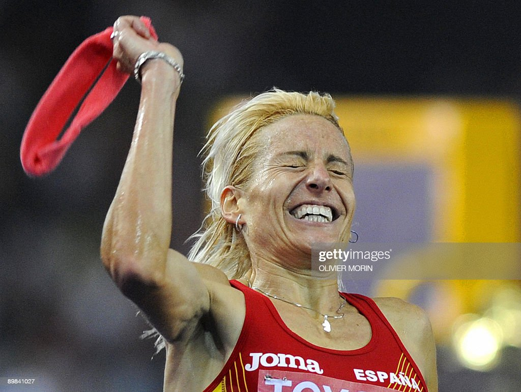 Spain's Marta Dominguez reacts as she crosses first the finish line of the women's 3000m steeplechase final of the 2009 IAAF Athletics World Championships on August 17, 2009 in Berlin.