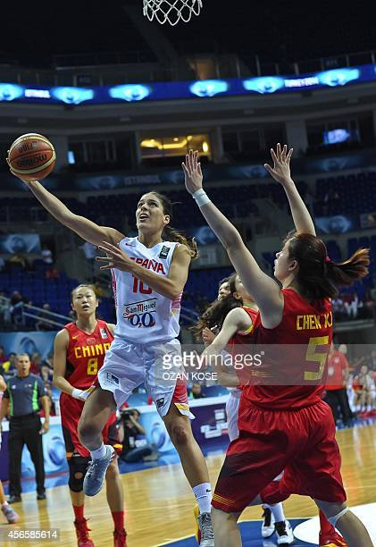 Spain's Marta Xargay challenges China's Chen Xiaojia during the 2014 FIBA Women's World Championship quarterfinal basketball match between Spain and...