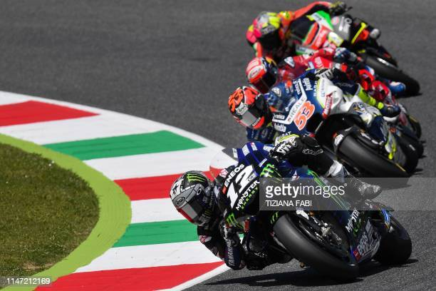 Spain's Maverick Vinales rides his Yamaha followed by Spain's Esteve Rabat riding his Ducati during free practice 4 ahead the Italian Moto GP Grand...