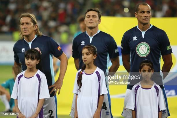 Spain's Michel Salgado Argentina's Javier Zanetti and Brazilian player Rivaldo pose prior to an exhibition football match between Iraq's allstar team...