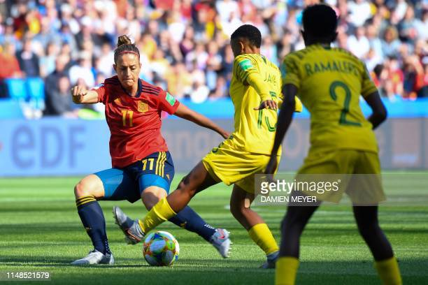 Spain's midfielder Alexia Putellas vies for the ball with South Africa's midfielder Refiloe Jane during the France 2019 Women's World Cup Group B...