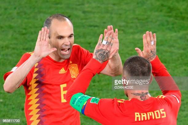 TOPSHOT Spain's midfielder Andres Iniesta and Spain's defender Sergio Ramos celebrate their second goal during the Russia 2018 World Cup Group B...