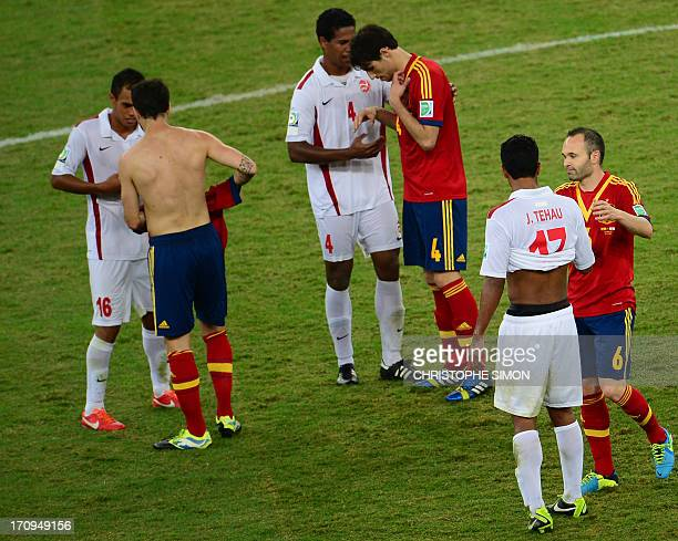 Spain's midfielder Andres Iniesta and Tahiti's midfielder Jonathan Tehau Spain's midfielder Javier Martinez and Tahiti's defender Teheivarii Ludivion...