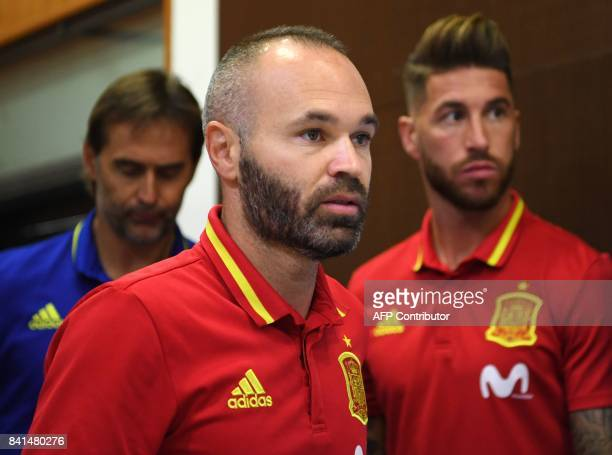 Spain's midfielder Andres Iniesta arrives followed by Spain's defender Sergio Ramos and Spain's coach Julen Lopetegui to give a press conference at...