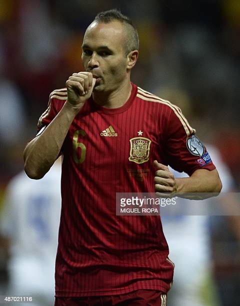 Spain's midfielder Andres Iniesta celebrates after scoring a goal during the Euro 2016 qualifying football match Spain vs Slovakia at the Carlos...