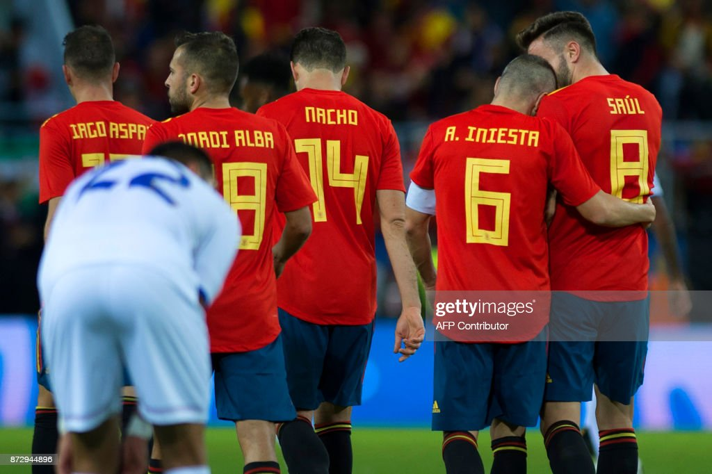 Spain's midfielder Andres Iniesta (2nd R) celebrates with midfielder Saul (R) after scoring during the international friendly football match Spain against Costa Rica at La Rosaleda stadium in Malaga on November 11, 2017. /