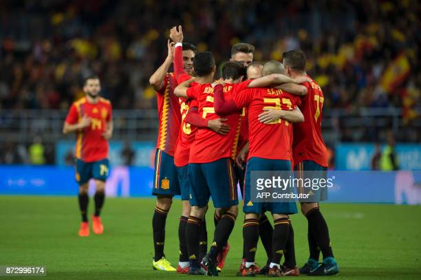 Spain's midfielder Andres Iniesta celebrates with teammates after scoring during the international friendly football match Spain against Costa Rica...