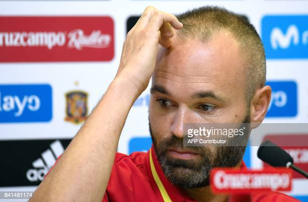 Spain's midfielder Andres Iniesta gestures as he gives a press conference at the Royal Spanish Football Federation's 'Ciudad del Futbol' in Madrid on...