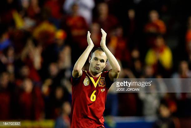 Spain's midfielder Andres Iniesta gestures as he leaves the pitch during the World Cup 2014 qualifying football match Spain vs Georgia at the Carlos...