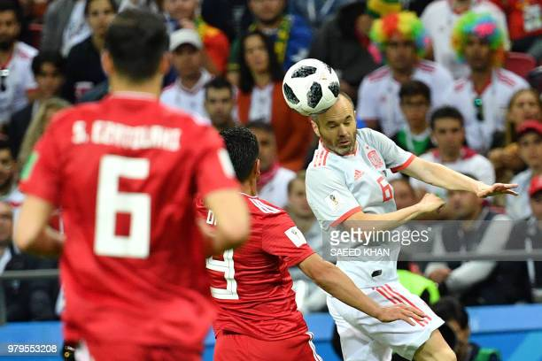 Spain's midfielder Andres Iniesta heads the ball during the Russia 2018 World Cup Group B football match between Iran and Spain at the Kazan Arena in...