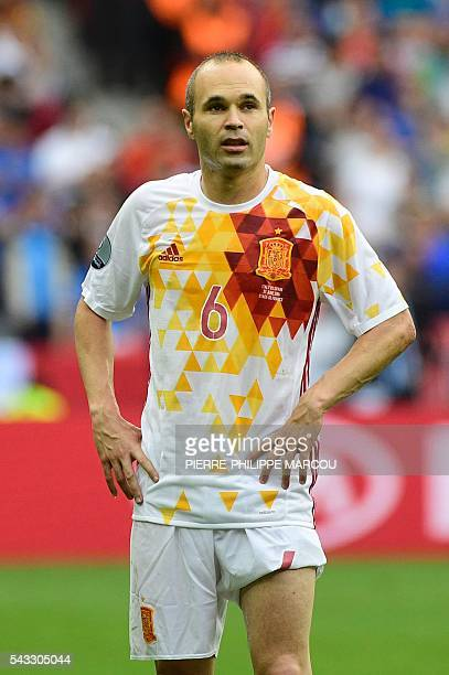 Spain's midfielder Andres Iniesta reacts during the Euro 2016 round of 16 football match between Italy and Spain at the Stade de France stadium in...