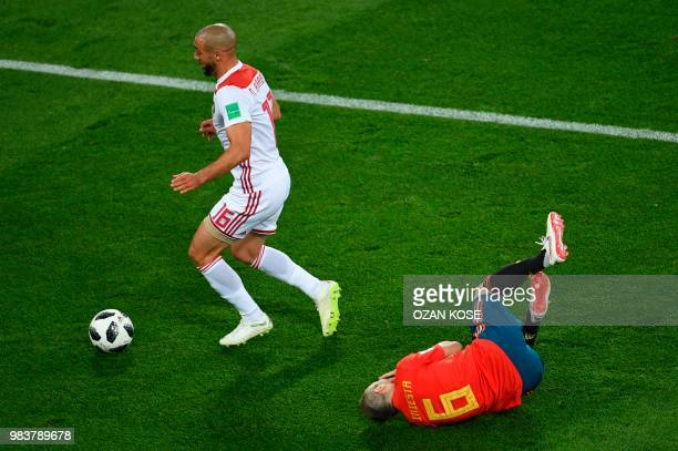 Spain's midfielder Andres Iniesta reacts past Morocco's forward Noureddine Amrabat during the Russia 2018 World Cup Group B football match between...