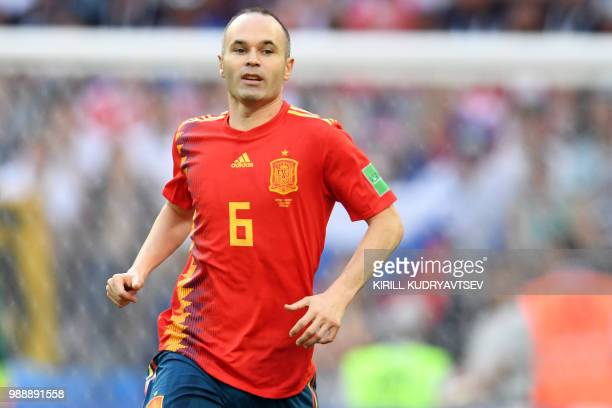 Spain's midfielder Andres Iniesta runs on the pitch during the Russia 2018 World Cup round of 16 football match between Spain and Russia at the...