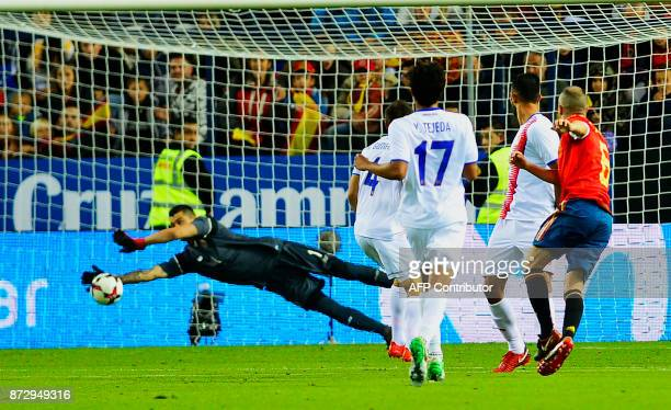 Spain's midfielder Andres Iniesta scores against Costa Rica's goalkeeper Danny Carvajal during the international friendly football match Spain...