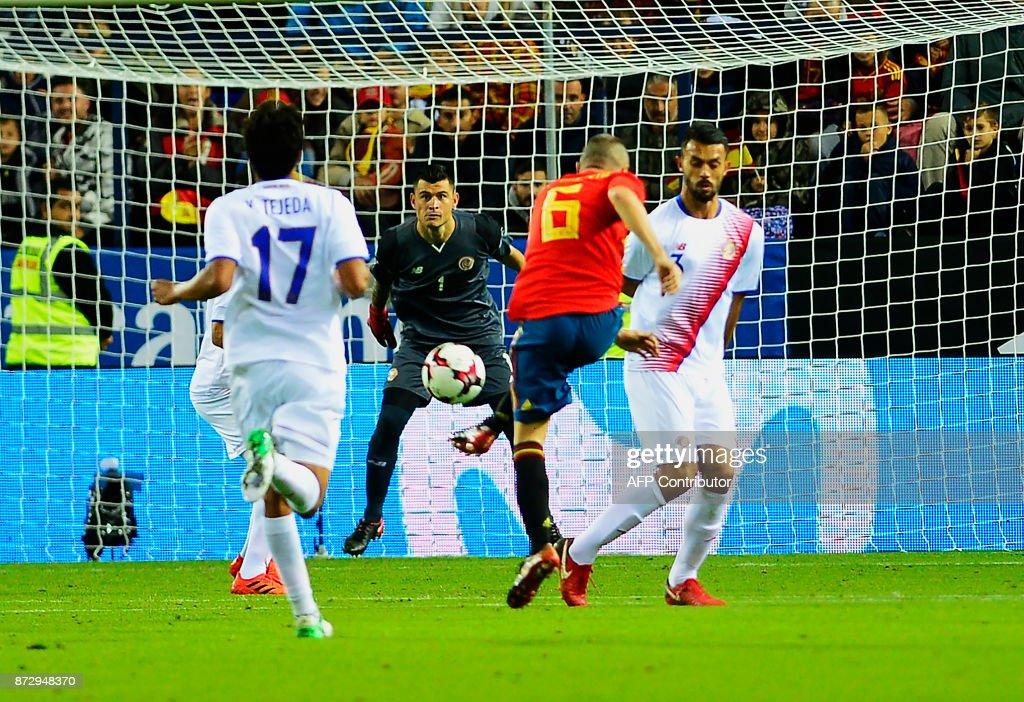 Spain's midfielder Andres Iniesta (C) scores during the international friendly football match Spain against Costa Rica at La Rosaleda stadium in Malaga on November 11, 2017. /
