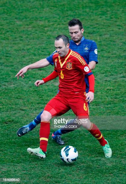 Spain's midfielder Andres Iniesta vies with France's midfielder Yohan Cabaye during the World Cup 2014 qualifying football match France vs Spain on...