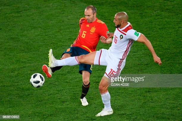 Spain's midfielder Andres Iniesta vies with Morocco's forward Noureddine Amrabat during the Russia 2018 World Cup Group B football match between...