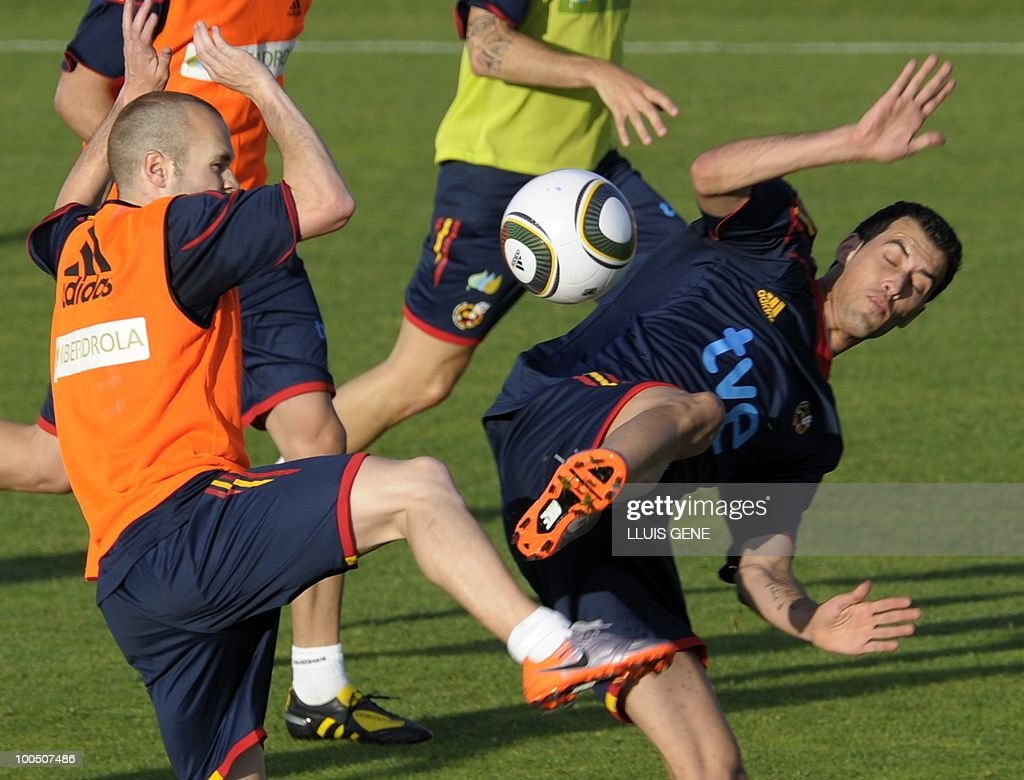 Spain's midfielder Andres Iniesta (L) vies with Spain's midfielder Sergi Busquets (R) during a training session of the Spanish football team on May 25, 2010, at the Sports City of Las Rozas, near Madrid. Spain, among the favourites for the World Cup, which runs from June 11-July 11, face Switzerland, Honduras and Chile in Group H of the opening round.