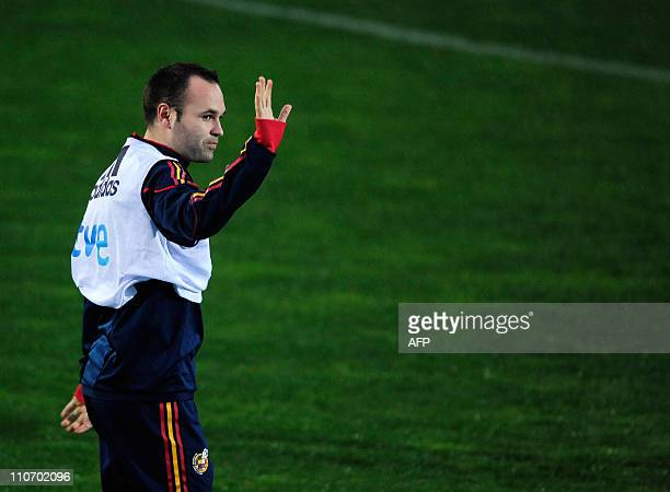 Spains midfielder Andres Iniesta waves to fans during a team training session in Las Rozas near Madrid on March 23 2011 Spain will face the Czech...
