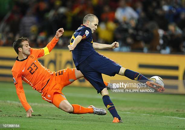 Spain's midfielder Andrés Iniesta shoots and scores a goal during extra time the 2010 FIFA football World Cup final between the Netherlands and Spain...
